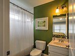 An en-suite bathroom provides comfort and privacy for guests.