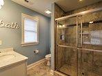 Guests will love this deluxe en-suite master bathroom.