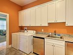 Keep your clothes fresh and clean in this fully stocked laundry room.