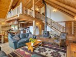 Lounge around the living room which features a wood-burning stove, 2 sumptuous leather couches, a rocking chair, and a...