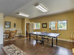 Work up a sweat at the ping pong table or sit down to a game of cards at the circular table with seating for 4.