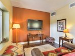 Enjoy a movie in the basement living room with a plush couch and a flat-screen satellite TV.