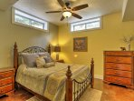 Lay back on the queen-sized bed in the downstairs master bedroom.