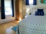 Comfortable full size bed with new coastal style furnishings.