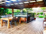 outdoor dining area with Jacuzzi hot tub