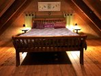 mezzanine bedroom with queen bed