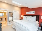 The master bedroom features a king sized bed, television and an ensuite bathroom.
