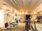 If you didn't get enough of a workout skiing or walking around town, there is a small fitness room in the basement for...