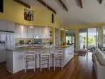 Create your next culinary masterpiece in the spacious kitchen (or enjoy a glass of wine and some cheese while you watch...