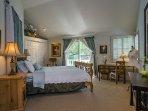 Master Bedroom #1 features a queen bed, balcony access and an en-suite bathroom.