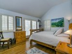 Guest bedroom #2, located on the main level, features a queen bed and private balcony with ocean view.