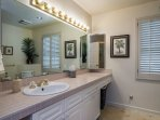 Guest bathroom, featuring a spacious countertop and mirror.