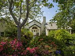 The home is tucked back and surrounded by beautiful foliage.