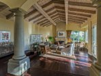 The living room features high ceilings, tuscan style and gas fireplace