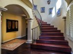 The open, curved staircase leads to the master suite