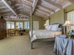 The spacious master suite (2nd floor) features a king size four post bed and ensuite bathroom