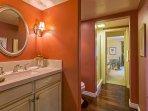 Ensuite bathroom to guest bedroom #3 (with shower) features hardwood floors