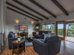 The second level living room has great views and glass doors that open up for a nice indoor/outdoor experience.