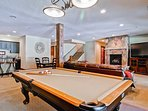 The massive downstairs game room is perfect for shooting pool, watching movies, and playing games.
