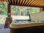 The hot tub is located conveniently just outside the downstairs game room.