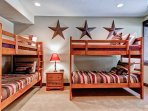 The downstairs Rodeo bunk room has two twin bunk beds, shared bath, and 32' flatscreen TV.