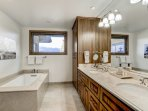 Enjoy a spa bath in this Kohler tub, or take a quick shower in the glass enclosed shower in the master bath (Master...