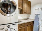 This laundry room is just outside the bathroom adjacent to Master bedroom #2.