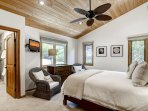 This comfortable Master bedroom #4 has a queen bed, flatscreen TV, private bath, and faces the garden area in front of...