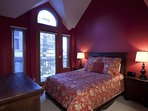Guest Bedroom #2 on the first floor has a queen bed, a private deck, and direct access to the slopes.