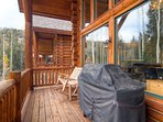 The deck is located off the living room.