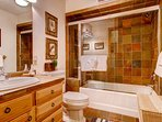 Guest Bathroom #2 is an ensuite featuring a shower/tub combo.