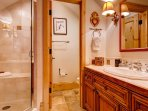 The loft bathroom features a walk in shower and private toilet room.