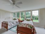 Step down into this charming twin bedroom on the lower level.
