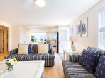 Kitchen is ideally situated between the two lounge areas.