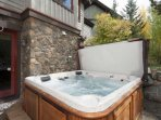 The Private Hot Tub is Secluded by Trees and Rocks for a Truly Restful View