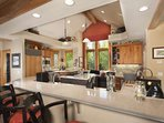 Well Equipped Gourmet Kitchen With lots of Counter Space and Social Area