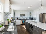 Chef's Kichen with Profesional Stainless Appliances, Prep Island and Breakfast Bar