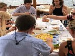 Our guests enjoying lunch on board our private boat
