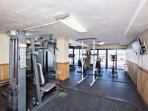 Fitness center with flat screen television.