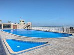 Enjoy the beach-side pools and pool deck where you can lounge and enjoy the crashing of the ocean waves.