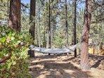 Swing between towering trees in the hammock.