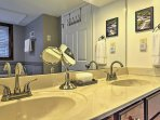 This spacious bathroom is complete with Jack-and-Jill sinks.