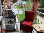 Suite #209 balcony with reclining lazyboy patio chairs & BBQ.