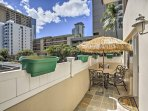 Kickback and relax on this expansive patio with a cafe table and views of the scenic Ala Wai Canal.