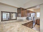 Cooking will be a breeze in this modern kitchen, complete  with stainless steel appliances and plenty of counter space.