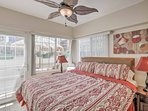 Enjoy scenic views through the balcony door from the comfort of your own bed.