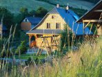 Skillfully crafted log cabins are nested in meadows and pastures. An ideal place for families.