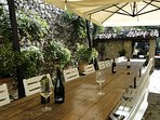 Dine al fresco in the walled courtyard, after using the outdoor grill, or wood oven!