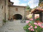 The original walled courtyard complete with relaxing area under Tuscan Arch