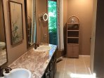 A full bath with garden view and new porcelain tile at Rochester Vacation House